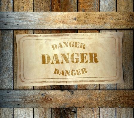 danger box: Stamp Danger label on old wooden box