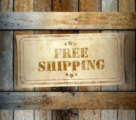 Stamp Free Shipping label on old wooden box photo