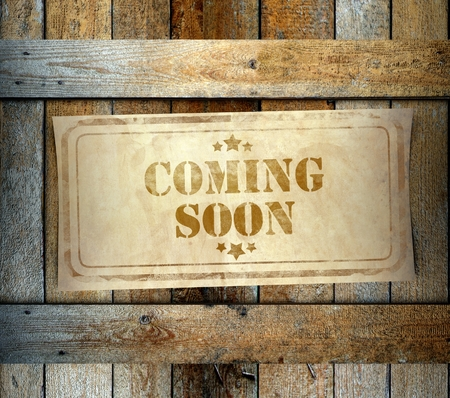 Stamp Coming Soon label on old wooden box