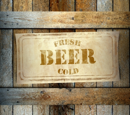 Stamp Fresh Cold Beer label on old wooden box photo