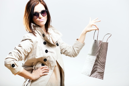 woman holding bag: Unhappy becouse of shooping woman holding bag