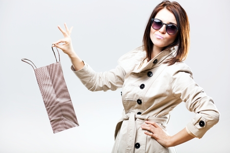 Disappointed becouse of gift woman holding shopping bag photo