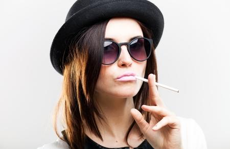 Retro fashion portrait of stylish young woman with cigarette photo