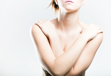 topless women: Natural woman covering her breasts arms, symbol of shyness