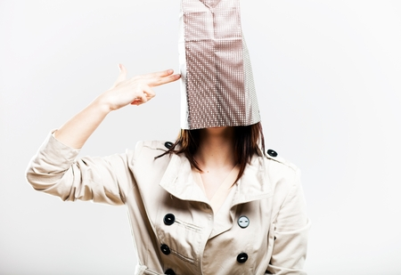 consumerism: Consumerism concept, fashionable woman with shopping bag on head