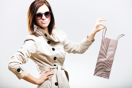 Disappointed becouse of shooping woman holding bag photo