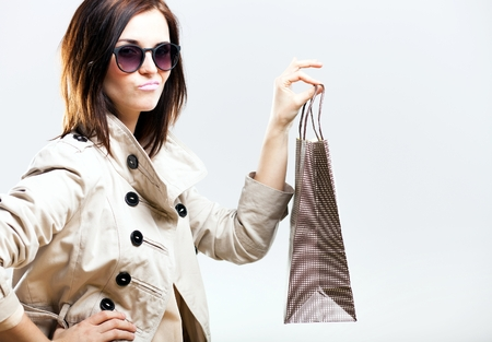 Unhappy becouse of shooping woman holding bag photo