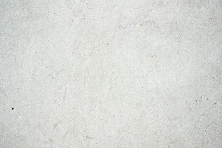 Grijze betonnen muur textuur, heldere witte achtergrond