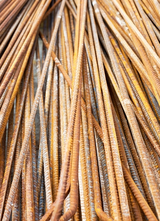 Steel rods used to reinforce concrete in construction, closeup photo
