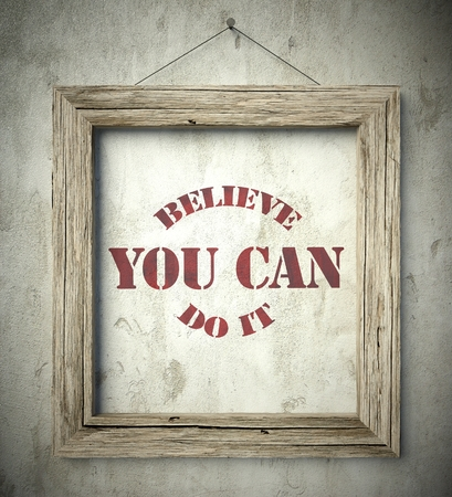 you can do it: Believe you can do it in old wooden frame on aged wall Stock Photo