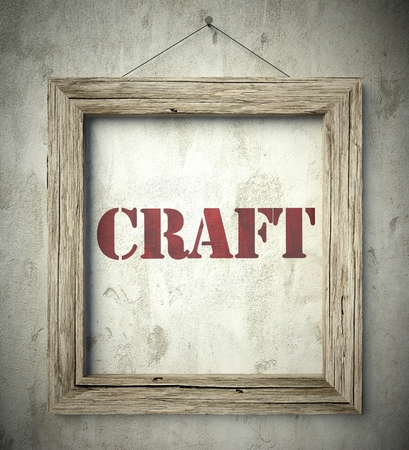 scraping: Craft in old wooden frame on aged wall