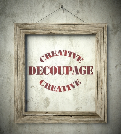 decoupage: Creative decoupage emblem in old wooden frame on aged wall