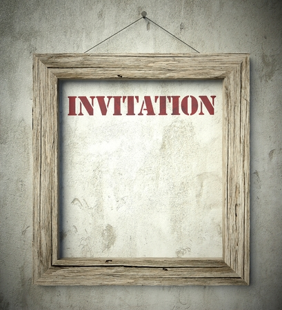 scraping: Invitation emblem in old wooden frame on aged wall