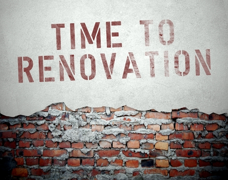 Time to renovation concept on old brick wall background photo