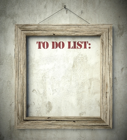 do: To do list in old wooden frame on aged wall
