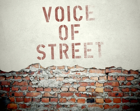 Voice of street concept on old brick wall background photo