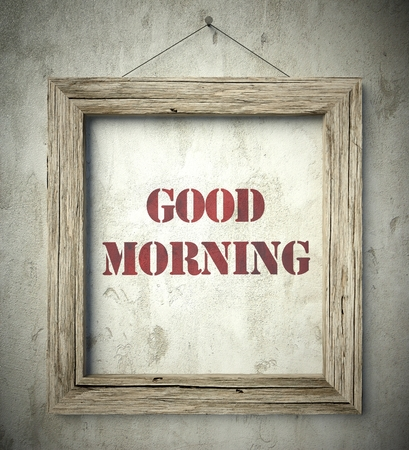 scraping: Good morning emblem in old wooden frame on aged wall Stock Photo