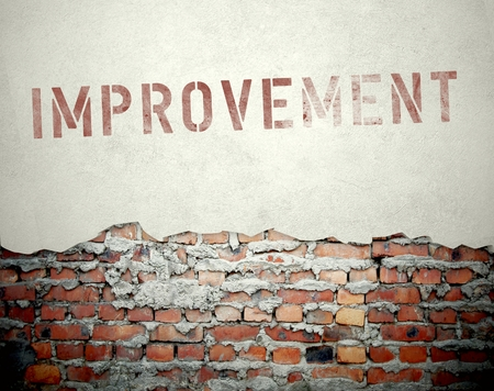 Improvement concept on old brick wall background photo
