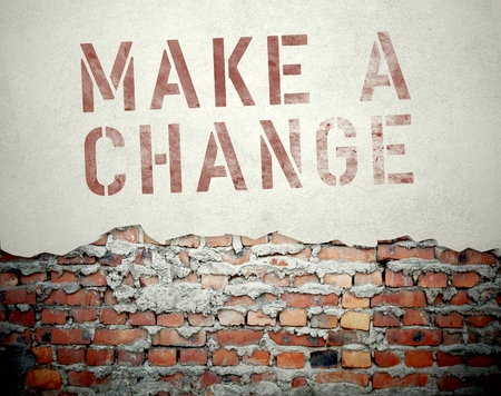 Make a change concept on old brick wall background photo