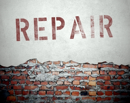 Repair concept on old brick wall background photo