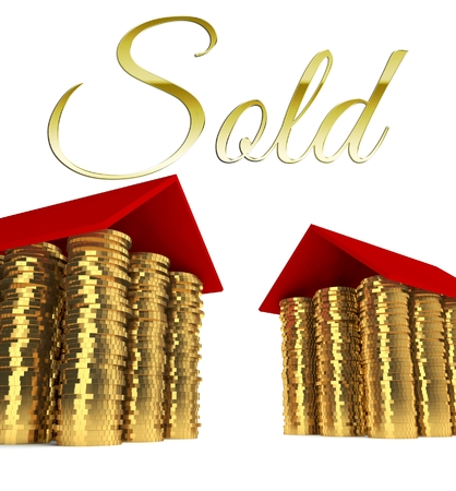 Sold home with houses made ??of coins photo