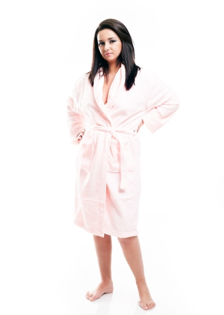 house robe: Full length portrait of young woman in bathrobe isolated white