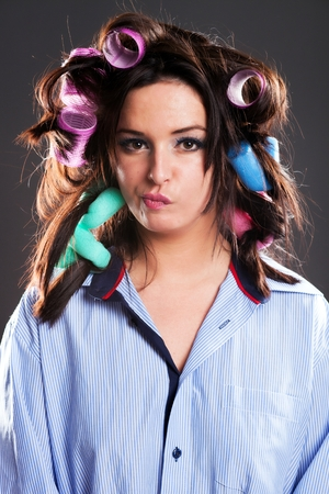 haircurlers: Funny woman hair with curlers preparing herself
