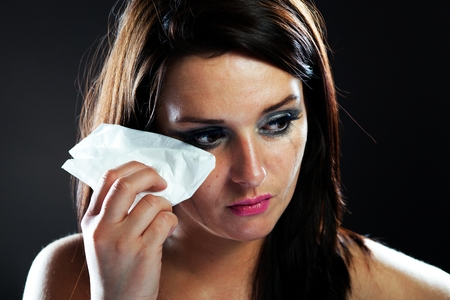 Hurt woman crying, face with smeared make up on dark background Stock Photo - 28211576