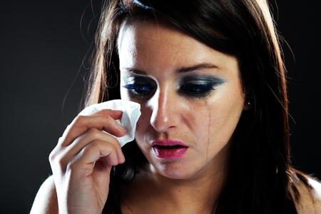 Hurt woman crying, face with smeared make up on dark background Stock Photo - 28211580