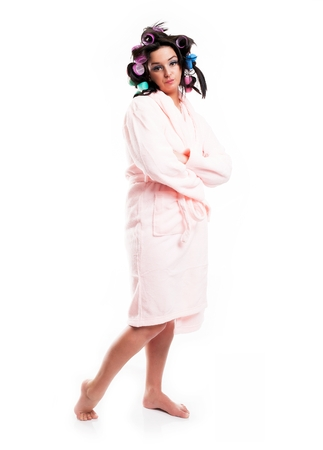Woman in bathrobe and hair with curlers, full length portrait isolated white photo
