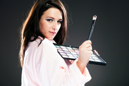 wife of bath: Woman in bathrobe and make up palette Stock Photo