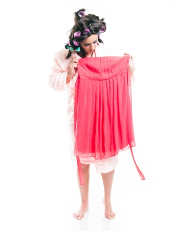 house robes: Woman in bathrobe choosing clothes, full length portrait isolated white