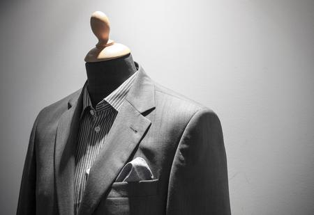 shopwindow: Elegant men suit on mannequin, shopwindow in apparel store