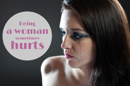 smeared mascara: Being a woman sometimes hurts quote Stock Photo