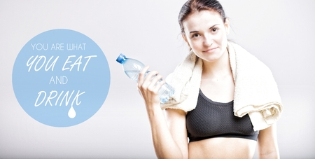 You are what you eat and drink, beautiful woman with bottle and towel