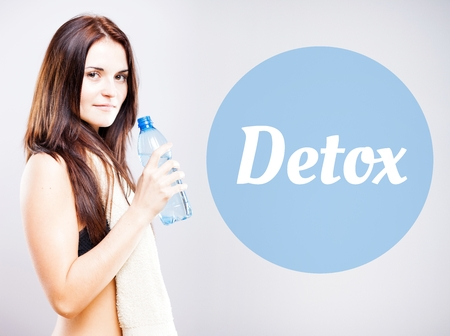 Detox, beautiful woman with bottle and towel photo