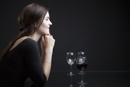 Luxury glamour woman in restaurant with glass of red wine photo