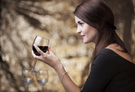 Elegant glamour woman in restaurant with glass of red wine photo