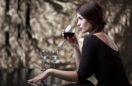glamour woman elegant: Glamour woman sitting alone in luxury restaurant Stock Photo