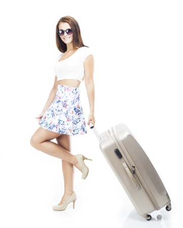 dragging: Tourist woman with wheel bag suitcase isolated white