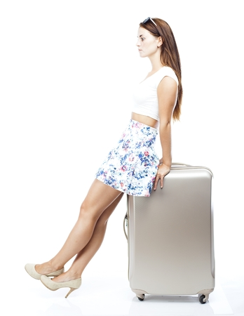 Unhappy and disappointed tourist woman with suitcase isolated white photo