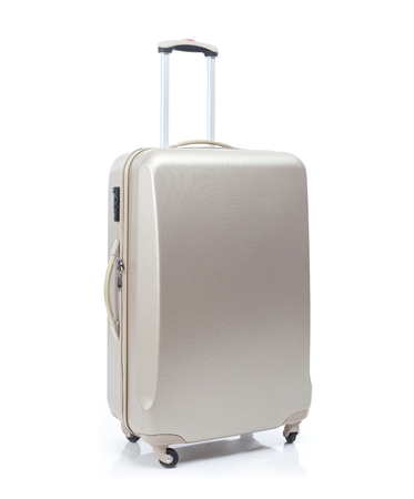 Big travel suitcase on wheels isolated white