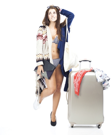 Tourist woman having problem with packing travel suitcase isolated white photo