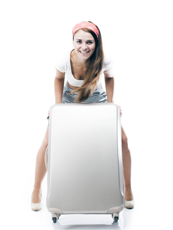 Tourist woman with wheel bag suitcase isolated white photo