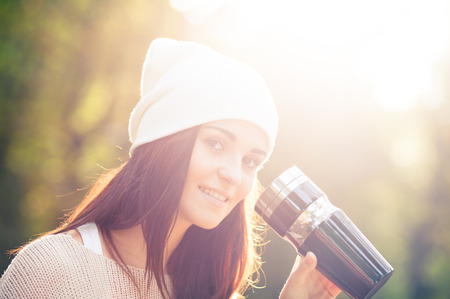 Young woman outdoor portrait in soft sunny daylight photo