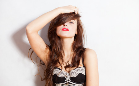 swagger: Closeup fashion studio portrait of hipster young woman