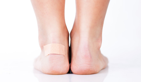 Closeup of woman's heel with blister plaster on, Women's problems