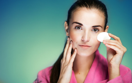 fresh girl: Beauty fresh girl cleaning face with cotton swab Stock Photo