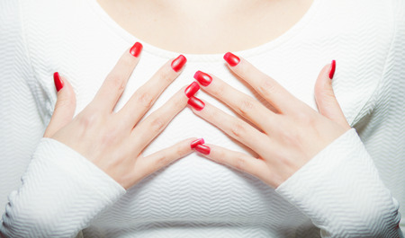 bodypart: Woman showing her red nails, manicure concept