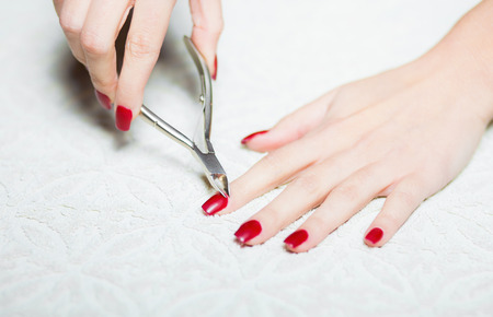 trimming: Woman hand manicure, trimming cuticles